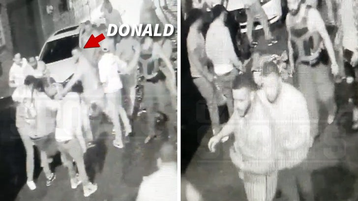 Aaron Donald Surveillance Video Shows NFL Star Pulling Mob Off Alleged Attacker.jpg