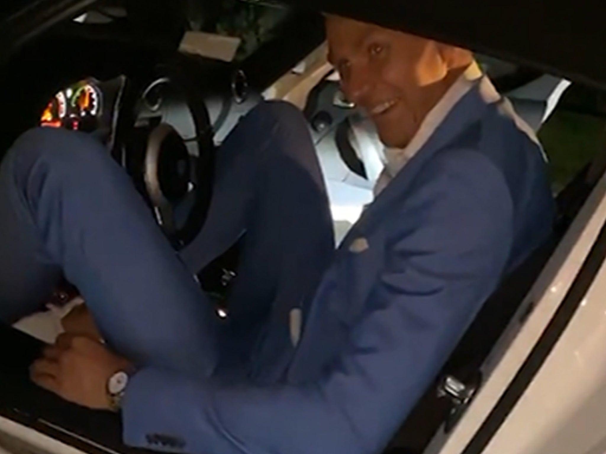 Kristaps Porzingis Hilariously Stuffs Himself Into Tiny Sports Car