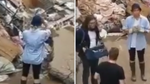 Reporter in Germany Smears Mud On Herself Pretending to Help Flood Cleanup
