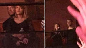 Calvin Harris Gives Taylor Swift the Suplex Treatment (PHOTO)