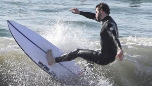 Liam Hemsworth Surfs After Sis-In-Law Says He Deserves Better Than Miley