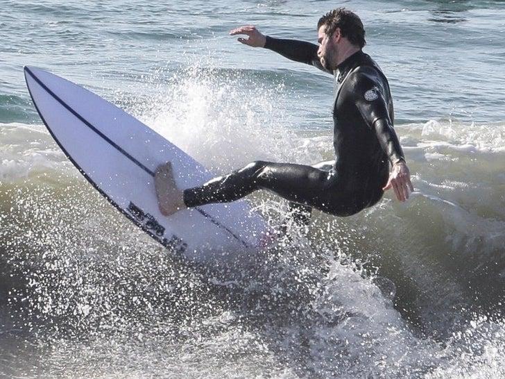 Liam Hemsworth Surfing in Malibu
