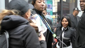 Lil' Kim Squares Up With Anti-Fur Protester in NYC