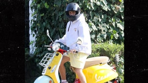 Justin Bieber Joy Riding Yellow Vespa in Los Angeles