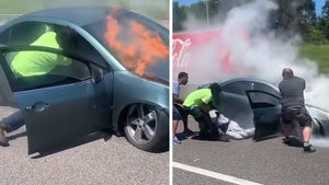 Man Trapped in Burning Car Saved by Good Samaritan at Last Second