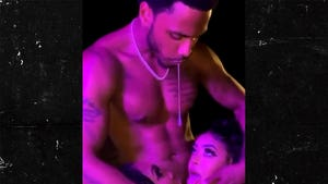 Trey Songz Spits Into Two Women's Mouths On What Appears to Be a Set