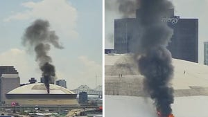 Superdome Roof Catches Fire, Flames & Smoke Billow From Saints' Stadium