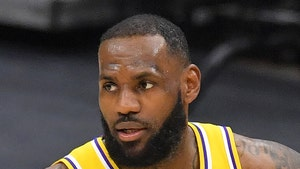 LeBron James Heckler Booted From Cavs-Lakers Game Over Offensive Shirts, Cops Say