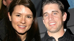 Danica Patrick Pops Champagne For Aaron Rodgers' New Deal
