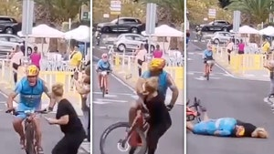Cyclist Suffers Head Injury After Violently Crashing Into Spectator