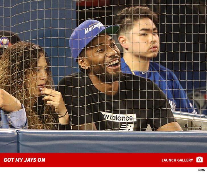 Kawhi Leonard watches the Toronto Blue Jays