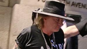 Axl Rose -- Settles Lawsuit With Loyal Roadie