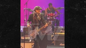 Johnny Depp Jams on Guitar During High School Charity Concert