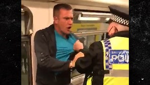 British Police Officer and Train Passenger in Wild Fight Over Face Mask