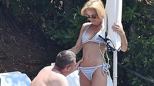 Gillian Anderson's Boyfriend gets Handsy on Steamy Italian Vacation
