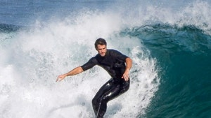 Liam Hemsworth Still Surfing in Australia