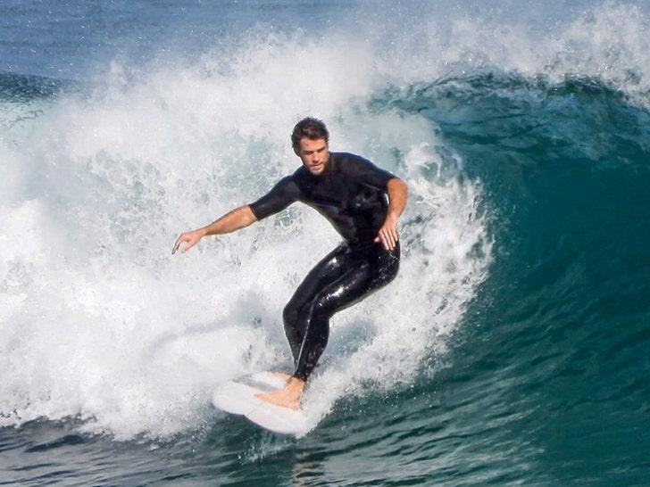 Liam Hemsworth Goes Surfing