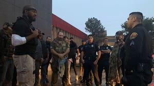 Jon Jones Returns to Streets to Stop Vandals, Leads Prayer Circle with Cops