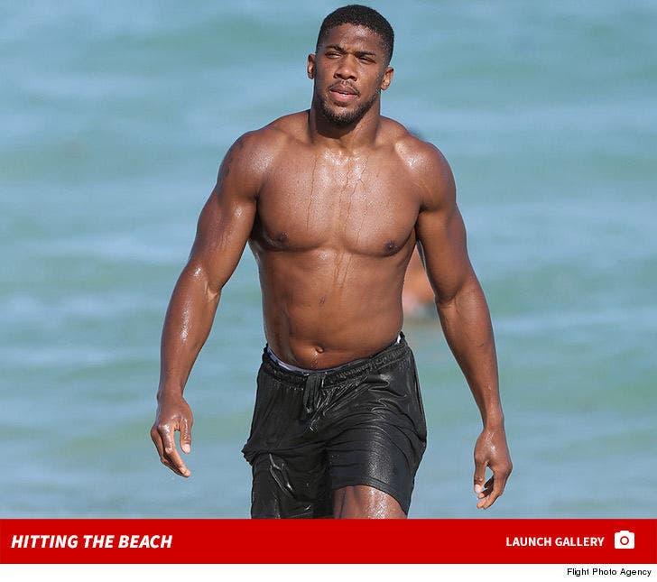 Boxer Anthony Joshua -- Hitting The Beach ... HARD