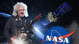 Queen Guitarist Brian May Writes Anthem For NASA's New Horizons Probe, And It Rocks