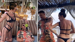 Brooks Koepka's GF Jena Sims Feeds Golf Star Grapes During Steamy Mexico Getaway