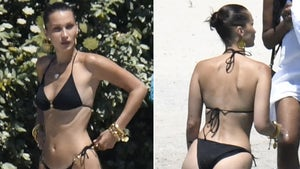 Bella Hadid Back to Work in a Black Bikini
