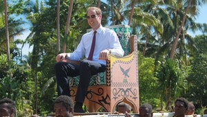 Prince William & Kate Carried on Thrones by People of Color in 2012