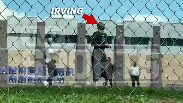 Kyrie Irving Plays Pickup Football Amid Vaccine Holdout Drama.jpg