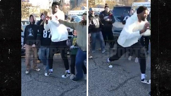 Philadelphia 76ers' Joel Embiid Shoves Eagles Fan During