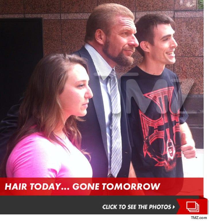 Triple H ... SHAVES HIS HEAD!!!