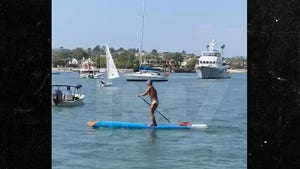 College Admission Scandal's Star Witness Back to Speedo Paddleboarding