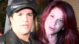 Slash Ordered to Pay Millions to Ex-Wife in Divorce Settlement