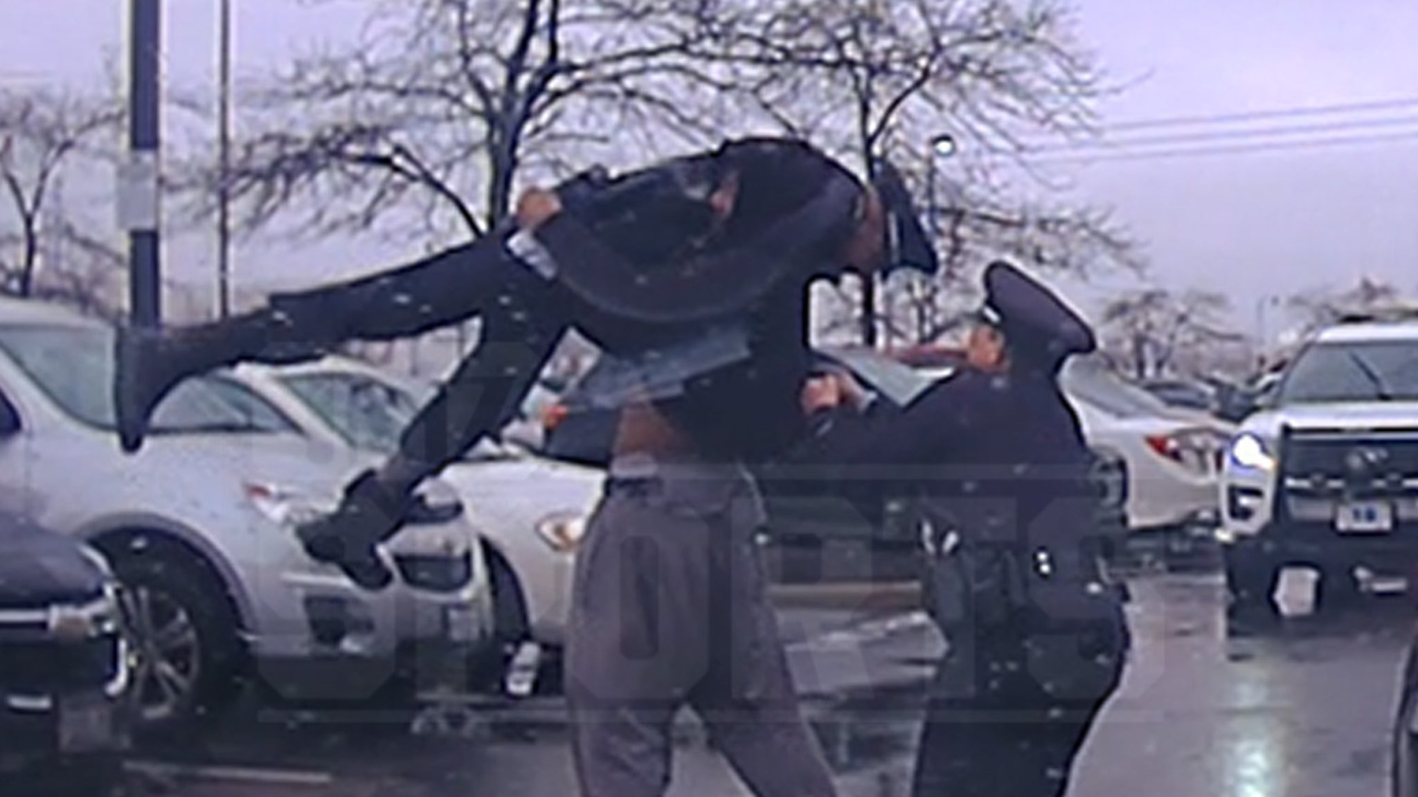 College Football Player Bodyslams Cop During Arrest, Insane Police Video