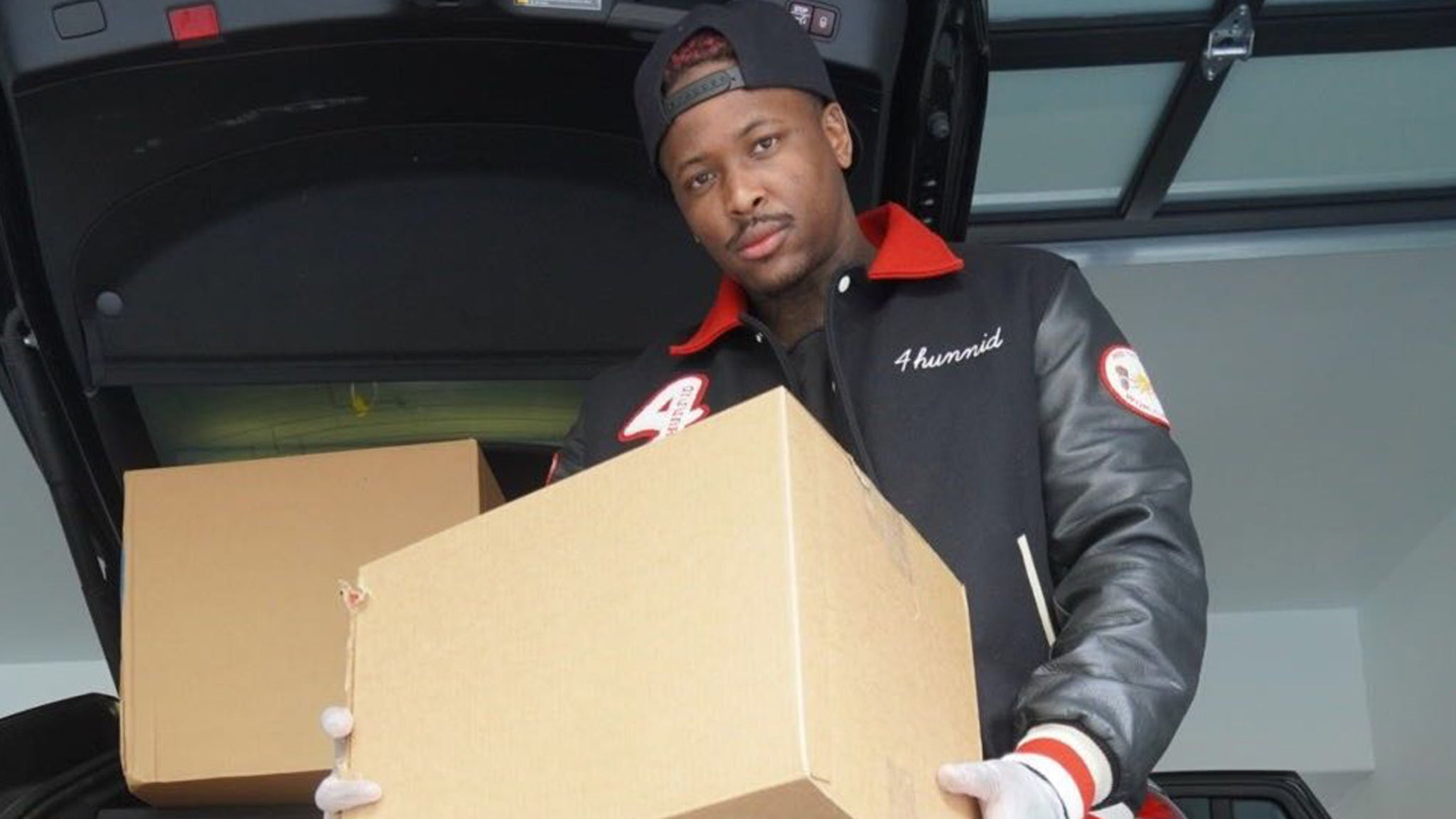 YG's Nonprofit 4Hunnid Ways Delivers PPE to Needy Families