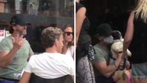 Gerard Butler Lowers Face Mask to Pose for Photo with Cute Dog