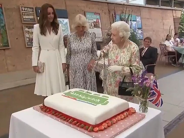Queen Elizabeth Insists on Cutting Cake with Sword, Testy with Aide.jpg