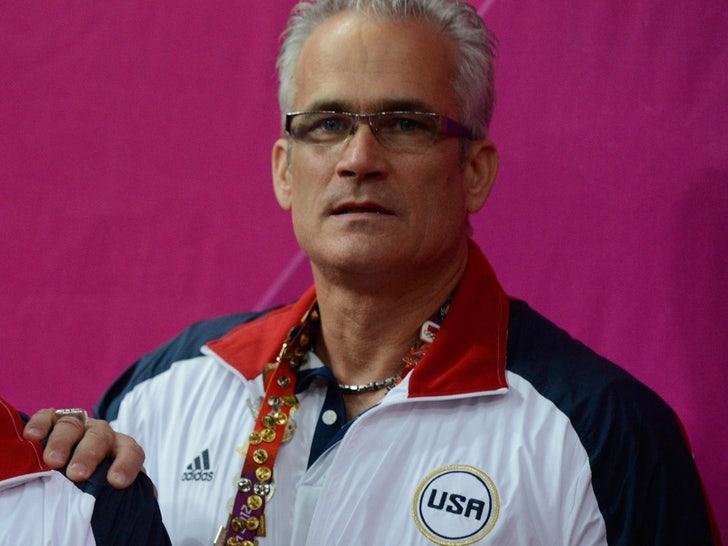 Ex-Team USA Gymnastics Coach John Geddert Charged with Sexual Assault, Human Trafficking.jpg