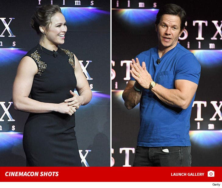 Rousey & Wahlberg Break Out The Big Guns for CinemaCon