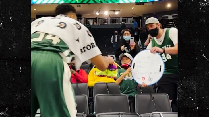 Giannis Antetokounmpo Gifts Sneakers To 8-Year-Old In Heartwarming Postgame Gesture.jpg
