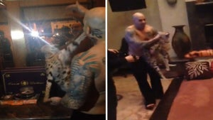 Celebrity Music Producer Subdues ANGRY African Wild Cat ... With His Bare Hands [VIDEO]