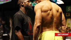 Logan Paul and Floyd Mayweather Square Off in Crazy, Pre-Fight Weigh-in