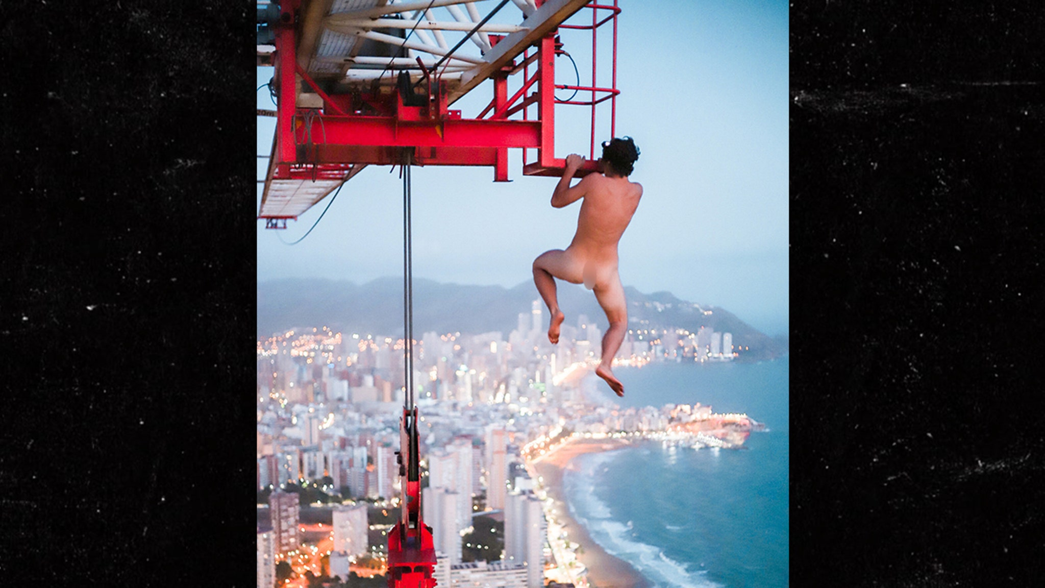 Daredevil Hangs Naked from 660-ft Crane…