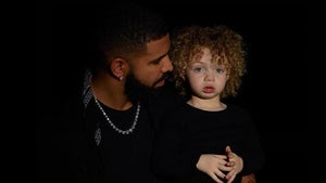 Drake Shares First Photos of Son Adonis, Blue Eyes & Blonde Afro