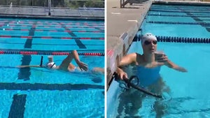 Katie Ledecky Swims Pool Length With Glass Of Milk On Head, No Spillage!