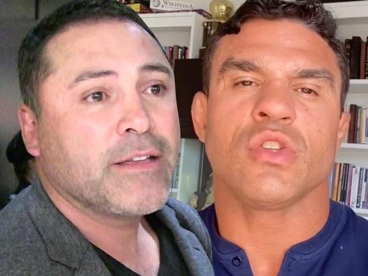 Oscar de la Hoya and vitor belfort fighting