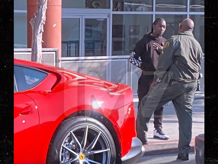 Offset pulled over in red ferrari