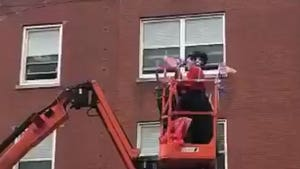Woman Rents Cherry Picker to Sing to Seniors in Nursing Home
