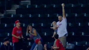 Dad Holding Baby Catches Foul Ball with 1 Hand, Amazing Video!