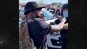 Cops Remove Protester's Mask And Pepper Spray Him