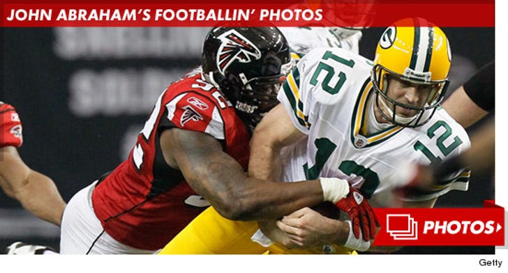 John Abraham -- Footballin' Photos